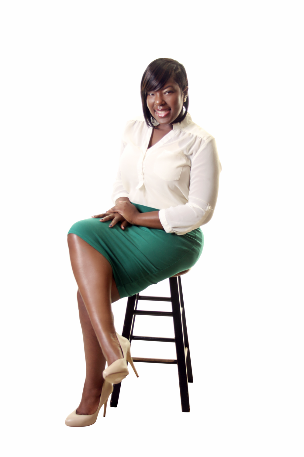 Shakeema Hughes - Author, Personal Finance Educator, and Your Credit Agent.  Founder and CEO of She Evolve LLC