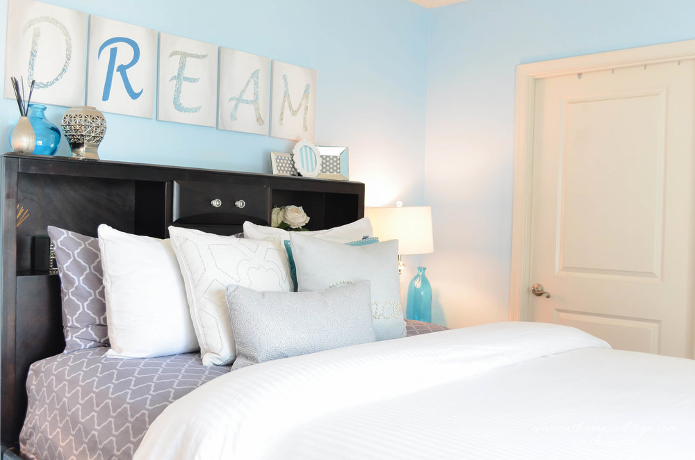 This calm & serene master bedroom retreat is the perfect design scheme for a couple, with just a touch of glamour. The light powder blue walls (Sherwin Williams Atmospheric, SW 6505) is a great color to give a refreshing, light & airy feel to a room.