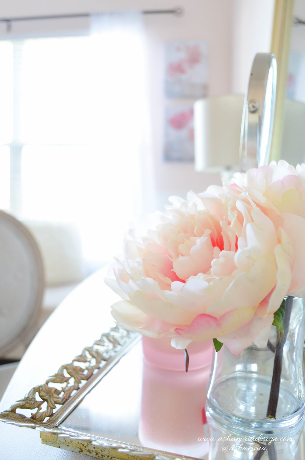 Intimate White Parisian Style Elegant Beauty Room with White Wainscoting, White Traditional Makeup Vanity with Gilded Mirror and Peonies in Vase Close Up