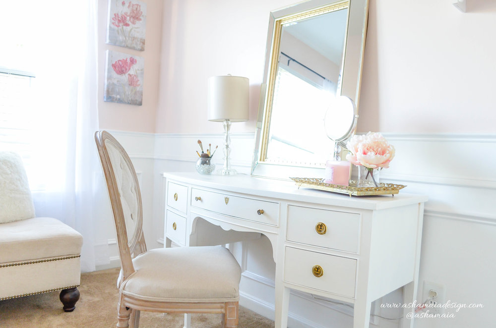 Intimate White Parisian Style Elegant Beauty Room with White Wainscoting, White Traditional Makeup Vanity with King Louis Chair, Gilded Mirror and Peonies in Vase