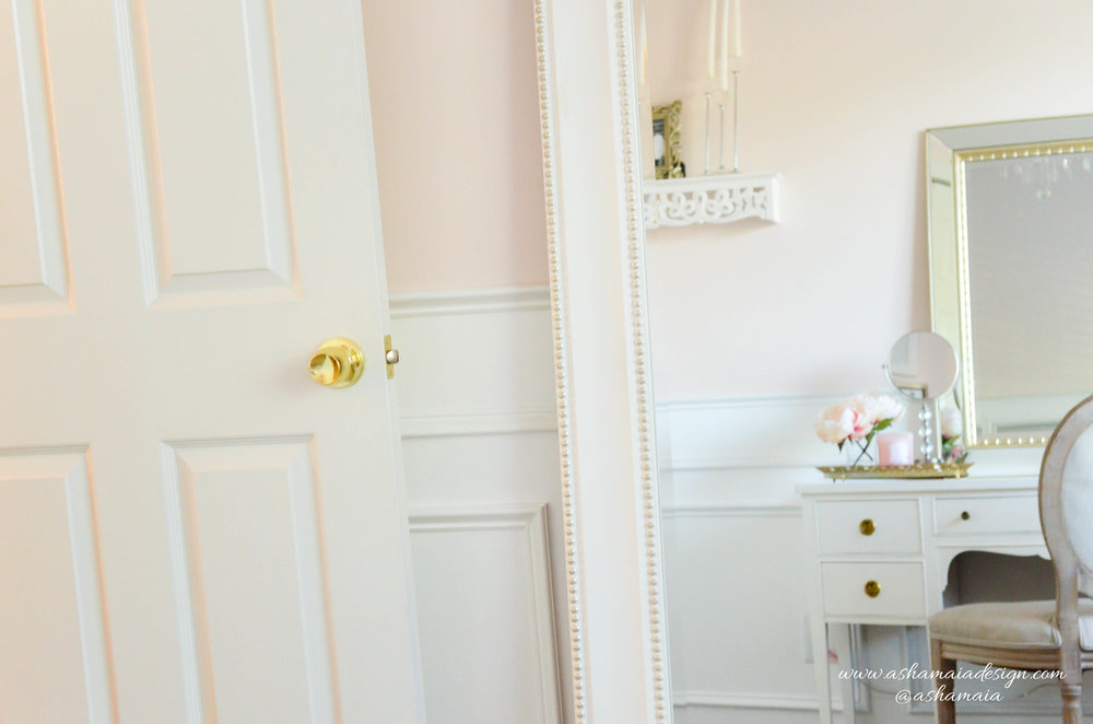 Intimate White Parisian Style Elegant Beauty Room with Large Full Length Mirror, White Wainscoting, White Traditional Makeup Vanity with King Louis Chair and Gilded Mirror