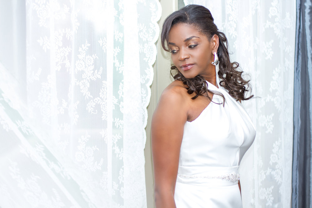 Lachandra is such a stunning bride , this was taken in the Bridal sweet. The blue tones and lace curtains were to die for!