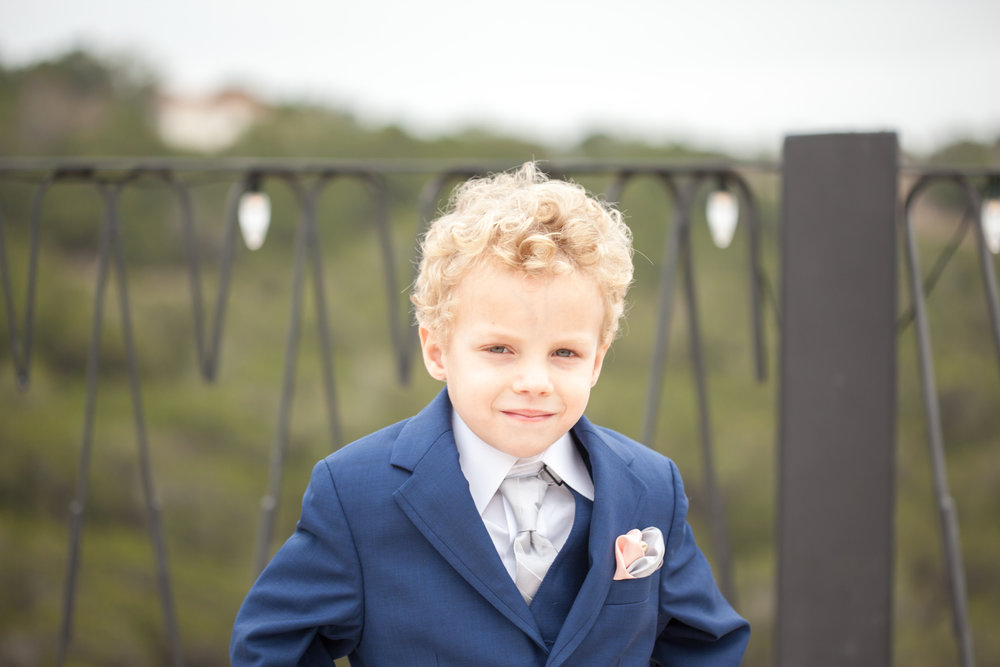 This little ring bearer was the sweetest little gentleman. He was all about pictures , and had his poses down! I just love it!!!