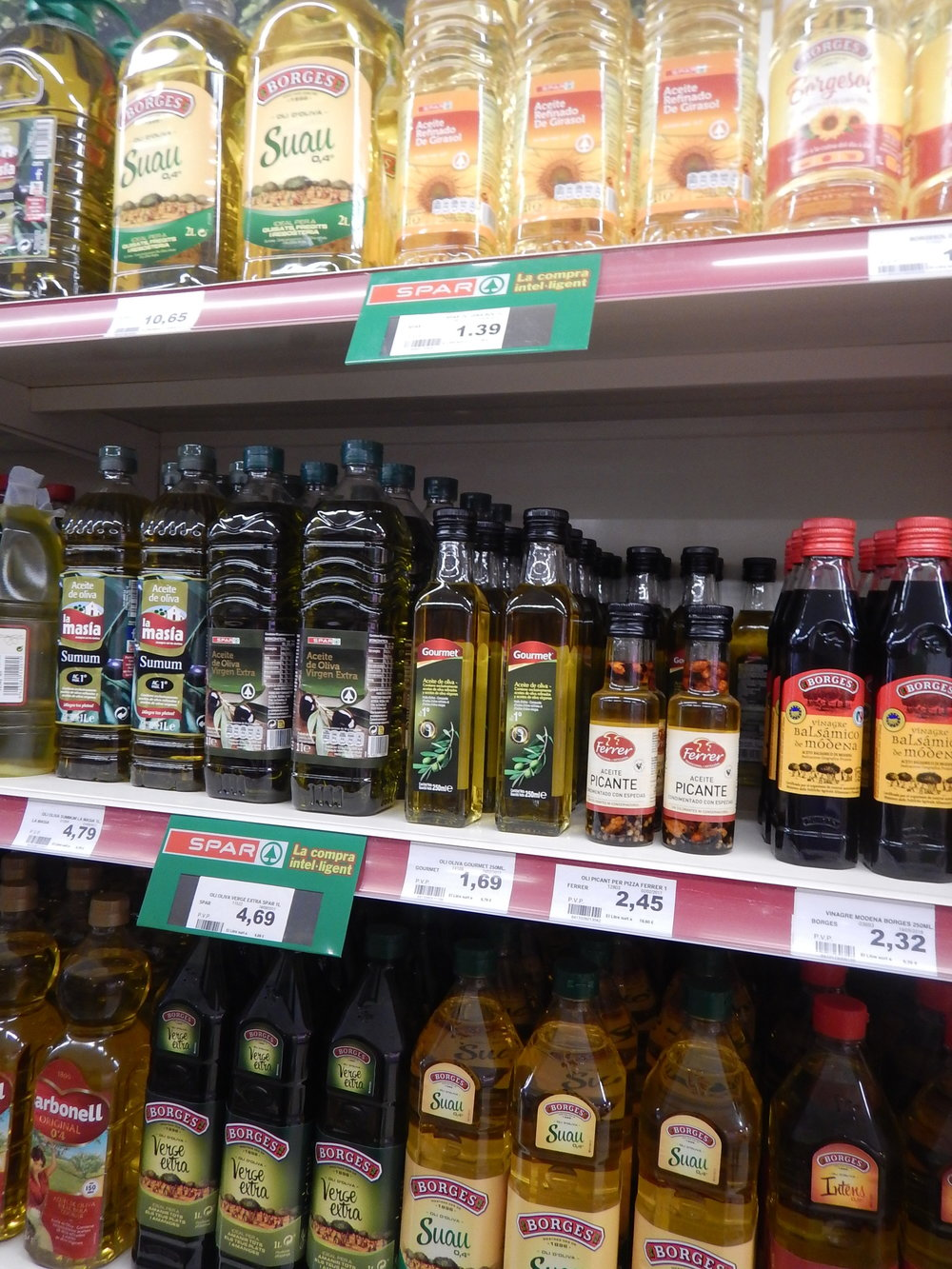 supermarket shelves offer a huge range of olive oils.