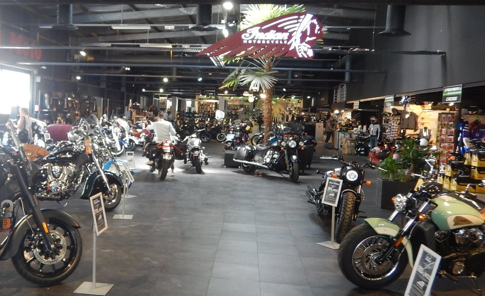 they ride my bike through the showroom to the workshop at the back