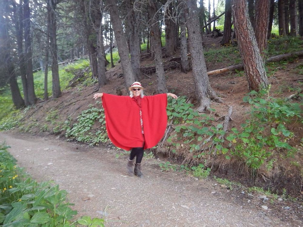 butterfly girl coming home from paragliding with her new red cape.