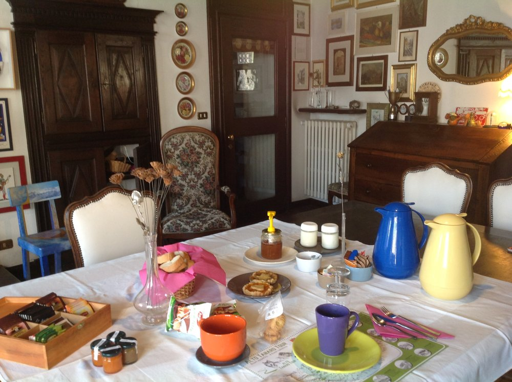 A colourful breakfast setting, and lots of home made goodies to enjoy, Italian style
