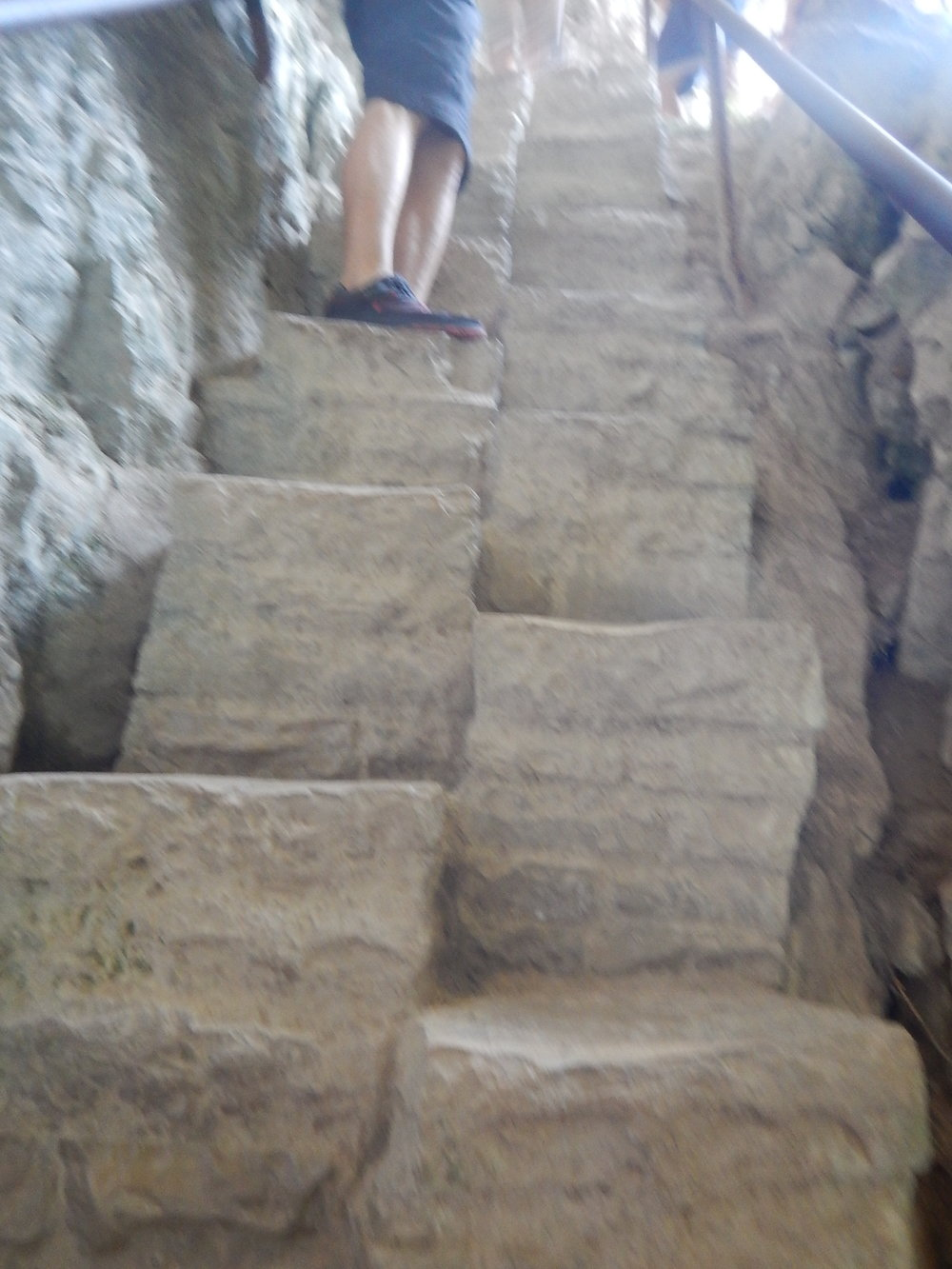 Alternating steps up into one of the caves.