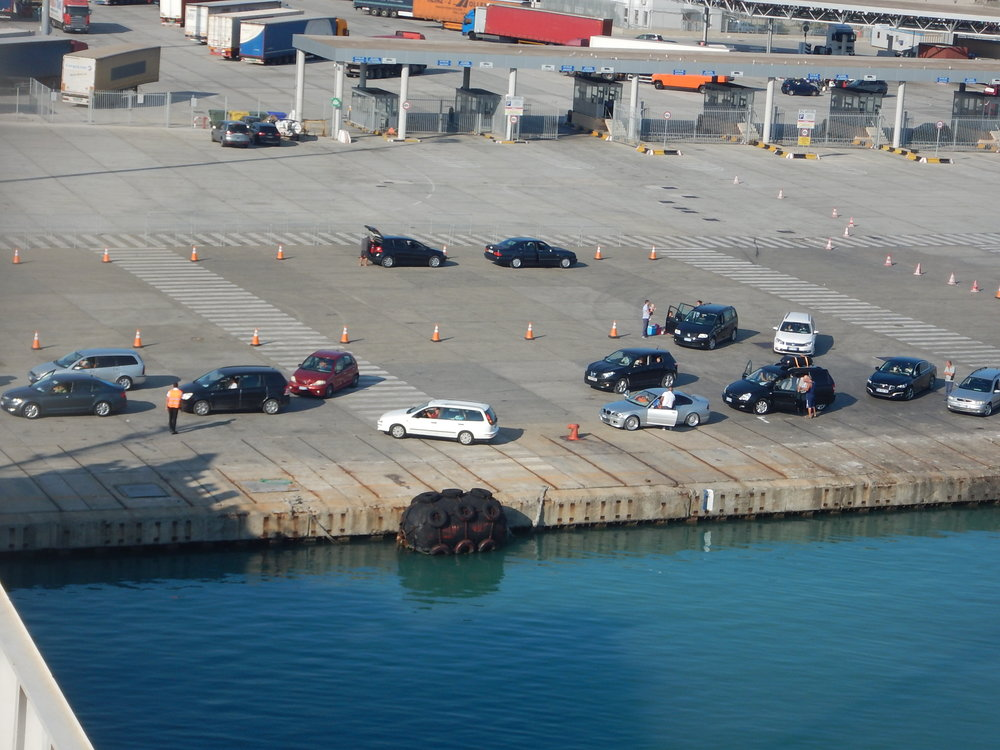 Italian drivers forming a queue to get on the ferry.