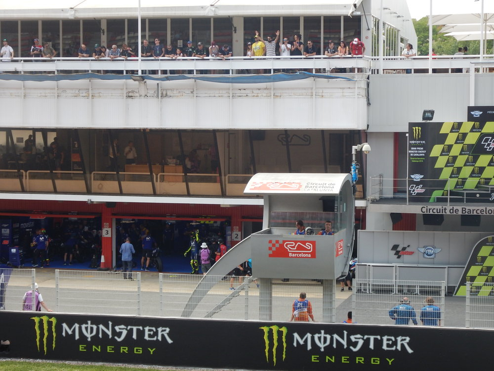 I spent a lot of time in the main grandstand directly opposite Rossi's garage. I did get a wave from him.