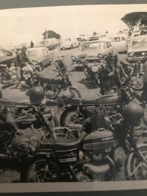 Our bikes at Phillip Island, 1973. Feet in the background, Beans, I think to the left. We travelled light, just a sleeping bag on the back and if it was cold we would have a bottle of Stones wrapped in the sleeping bag.