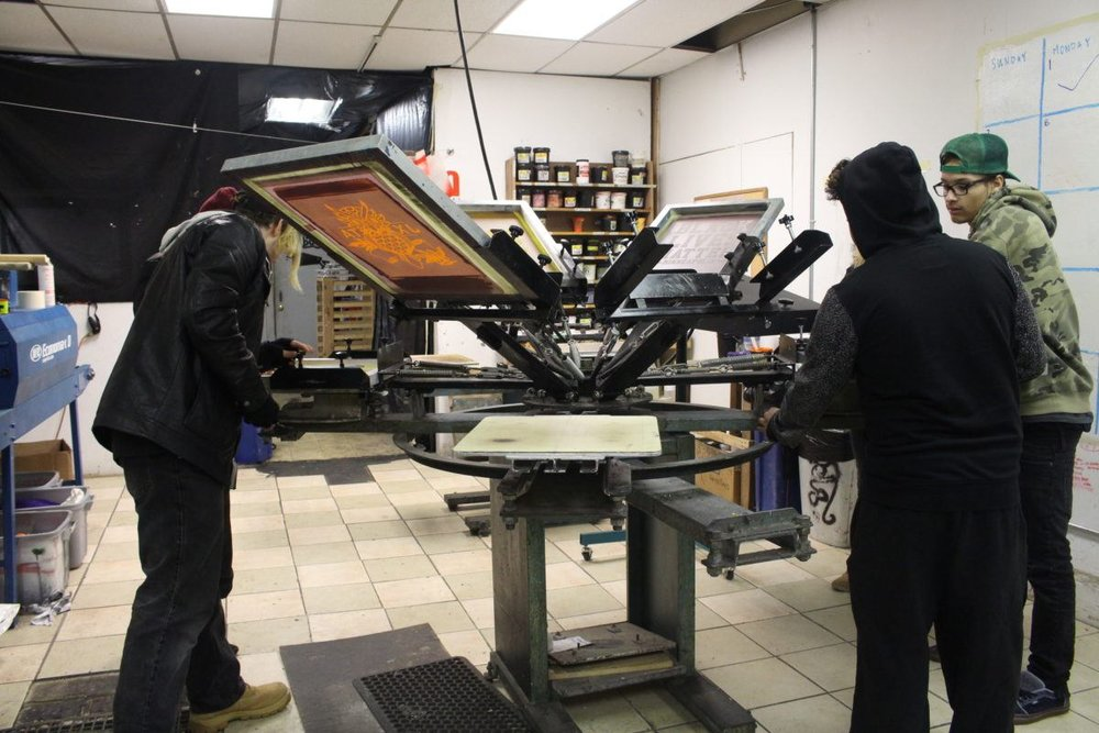 Youth apprentices build the screen printing press.