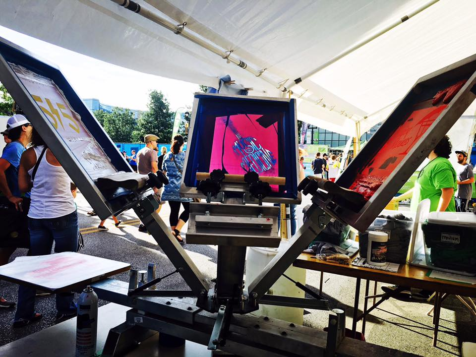 ArtForceIowa's mobile screenprinting unit advertising the  SctreetCred Studios  program at music festival 80/35 .  (2015)