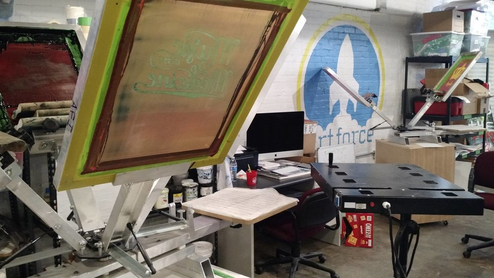 StreetCred Studios  is a full-service screen printing shop, and social enterprise helping lift employment obstacles for young adults with criminal backgrounds.