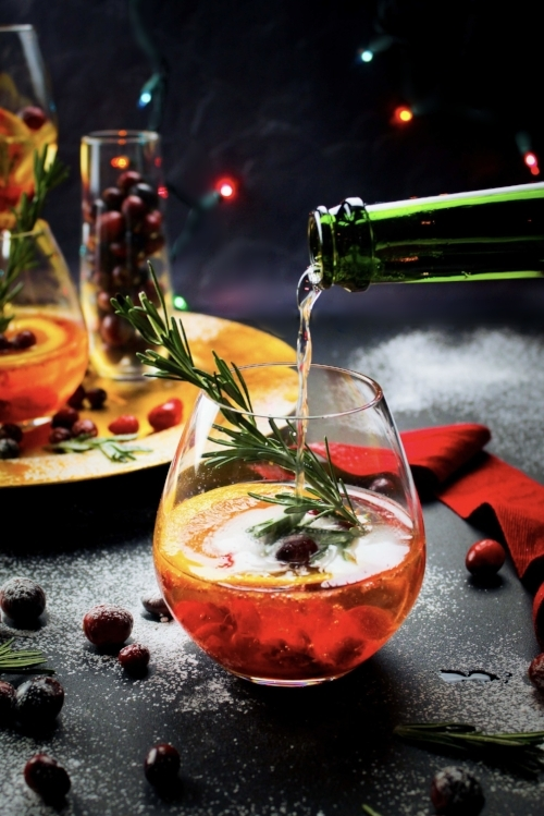 Cranberry Mimosas with ginger and rosemary