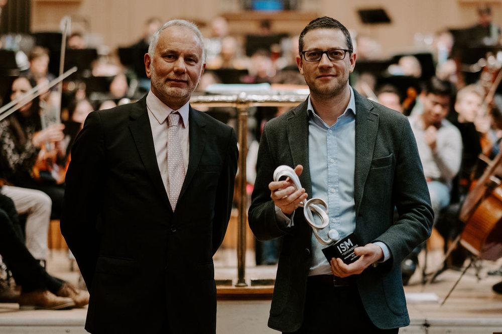 John receiving the award with ISM President David Saint. Photo © Samuel Taylor