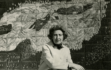 FÜREYA KORAL  in front of her ceramic wall panel in the Istanbul Textile Traders Market in 1966. Photo by Ara Güler. Courtesy Karşılaşmalar, Istanbul.
