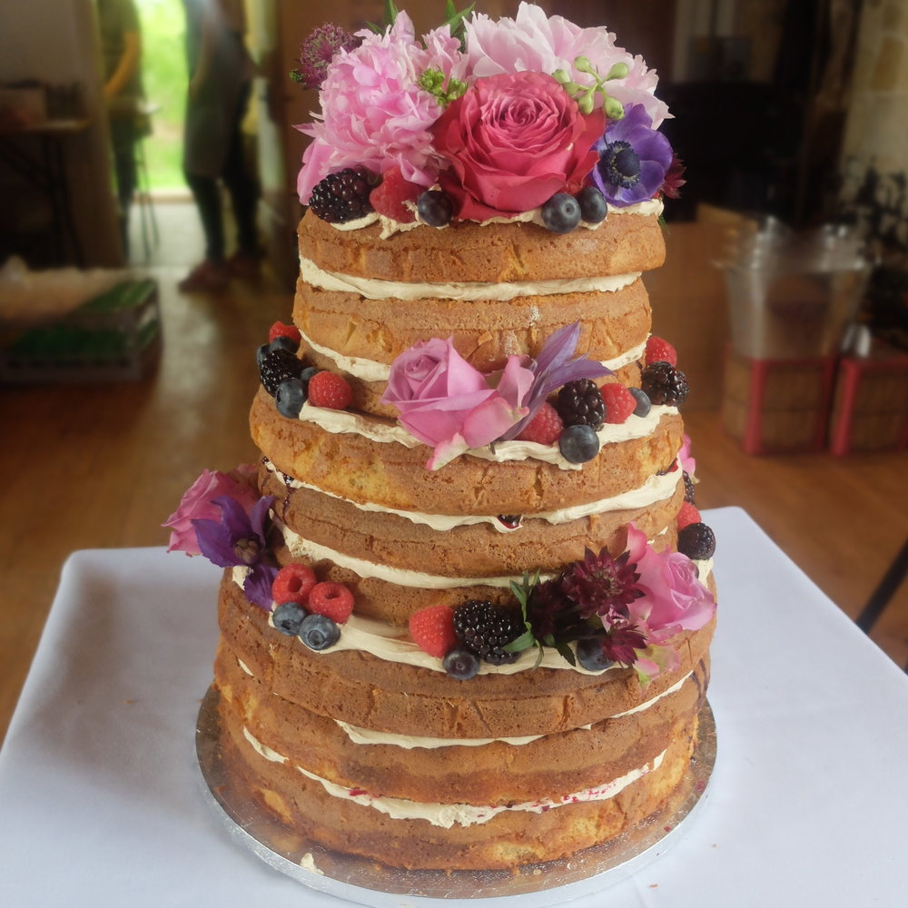 Naked Cakes - Naked cakes are quite the thing right now...They are made up of layers of sponge cake with fruit, jam, butter cream and ganaches. They are not iced so you can see the layers. Their semi dressed cousins have a thin layer of buttercream but you can still see the layers.Stacked up and decorated with fresh flowers, berries, meringues, macarons, they make a wonderful centre piece to your celebration.They can be made in one to four tiers to suit the amount of guests you are having.