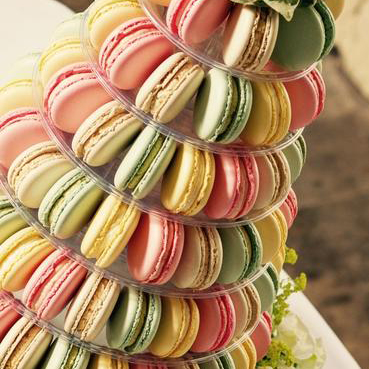 Macaron Towers - Macaron towers make a fantastic alternative to a traditional wedding cake.The beauty is that guests can walk up and help themselves from the tower of macarons on display. Sometimes choosing from multiple flavours.The towers can also be decorated with fresh flowers making them a real centre piece to your special day.We do different sizes to cater for your wedding or party so please get in touch to find out more and ask for a quote.