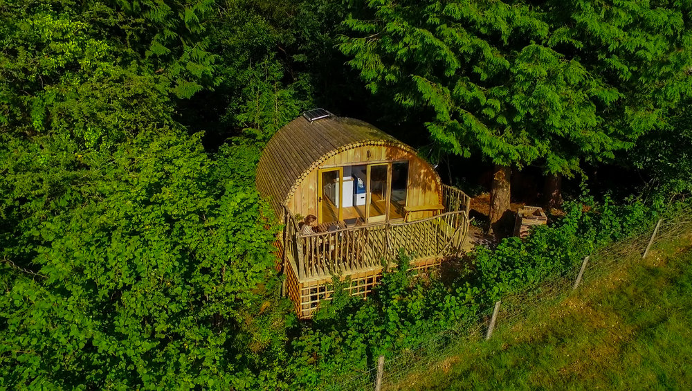 modu Log glamping pod in the woods