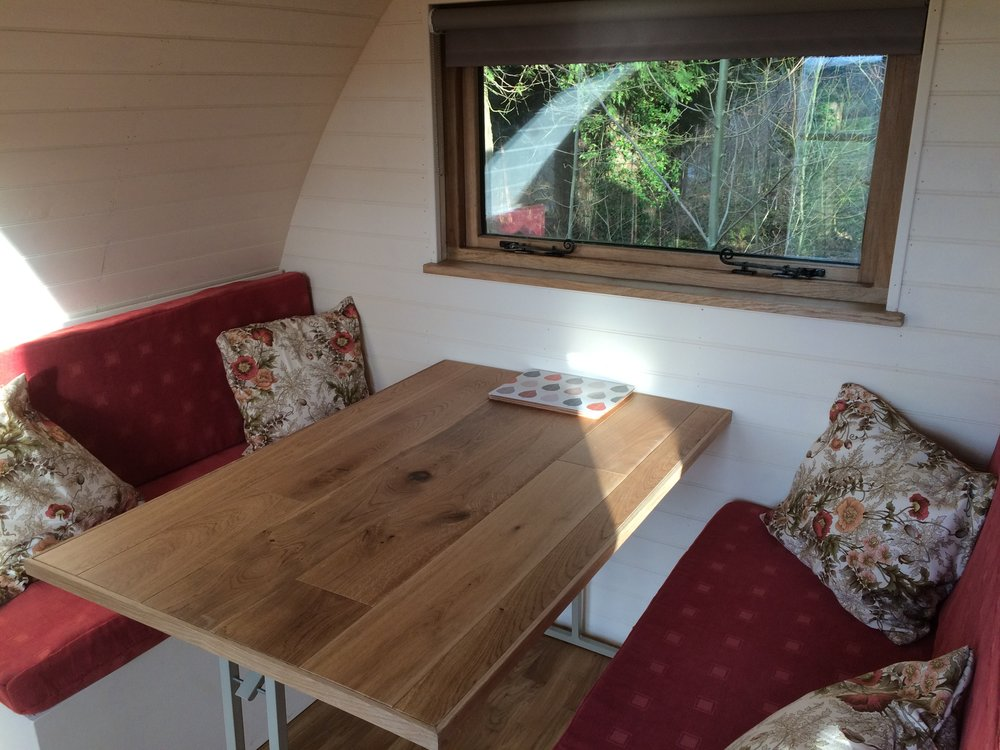 glamping pod table and chairs make a bed