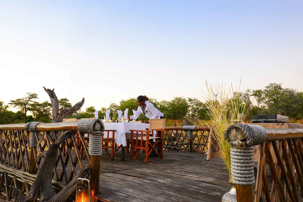 The Outdoor Deck - Want to experience eating under a starlit African sky? Then this is for you! Experience the magic and serenity of tuning in to all the sounds of the bush as the animals and other creatures of the wild prepare to sleep, hunt or avoid being prey. It is here that you will hear the crickets night song, and enjoy the aroma of oil lamps as you await the delicacies of the kitchen. Don't be surprised if you see elephants pass on by during the evening. This is an African experience at it's best!