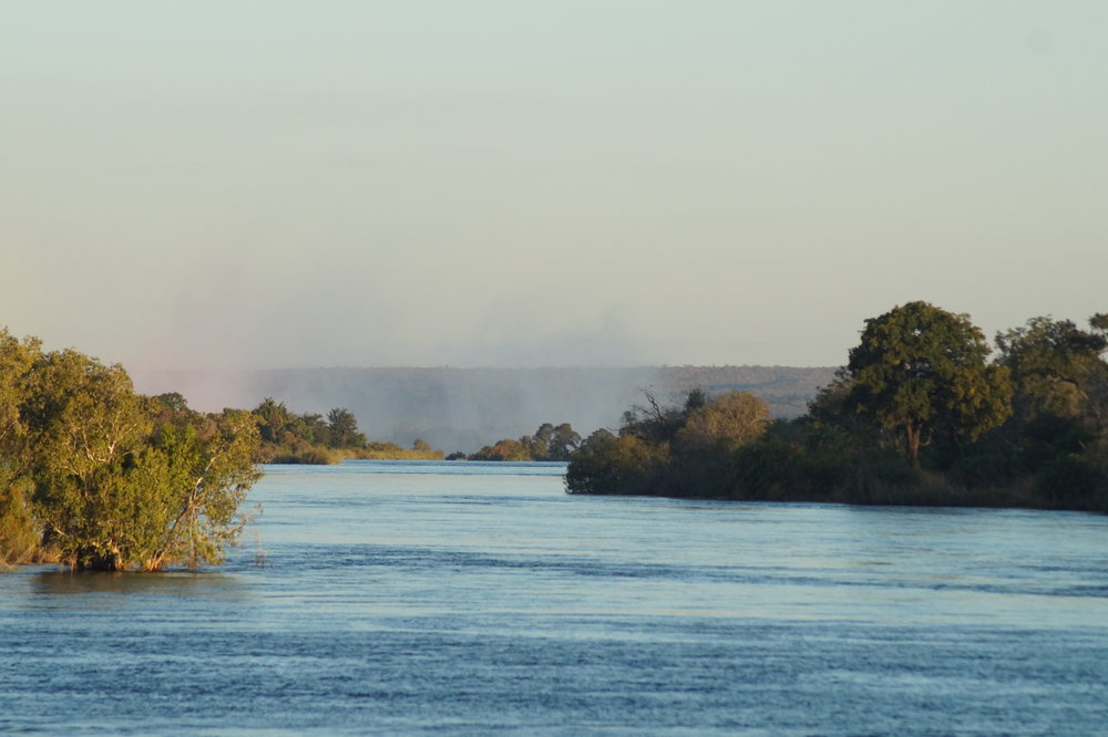 Zambezi River with mist from the Victoria Falls in the near distance