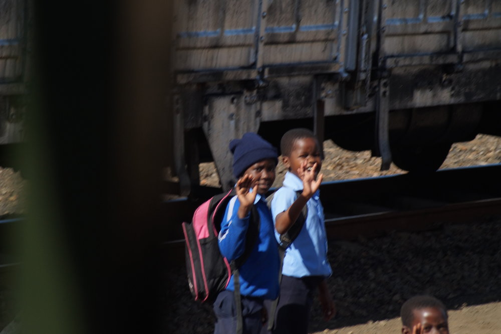 School children enroute to school along the railway line.