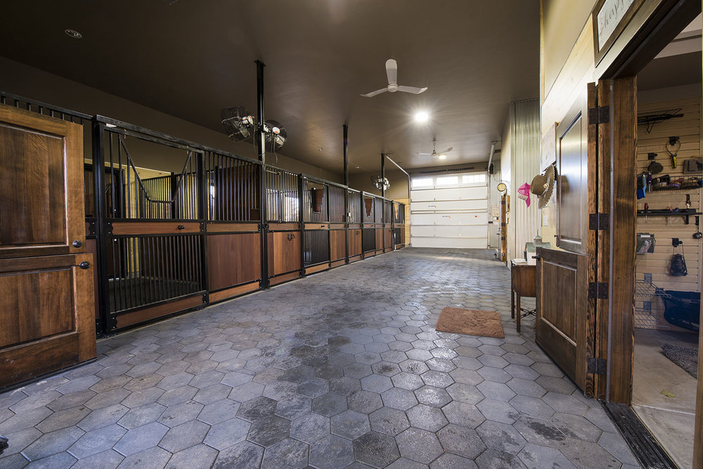 Rubber tiles, wood slatted stalls and iron trim make Franny's barn durable and beautiful.