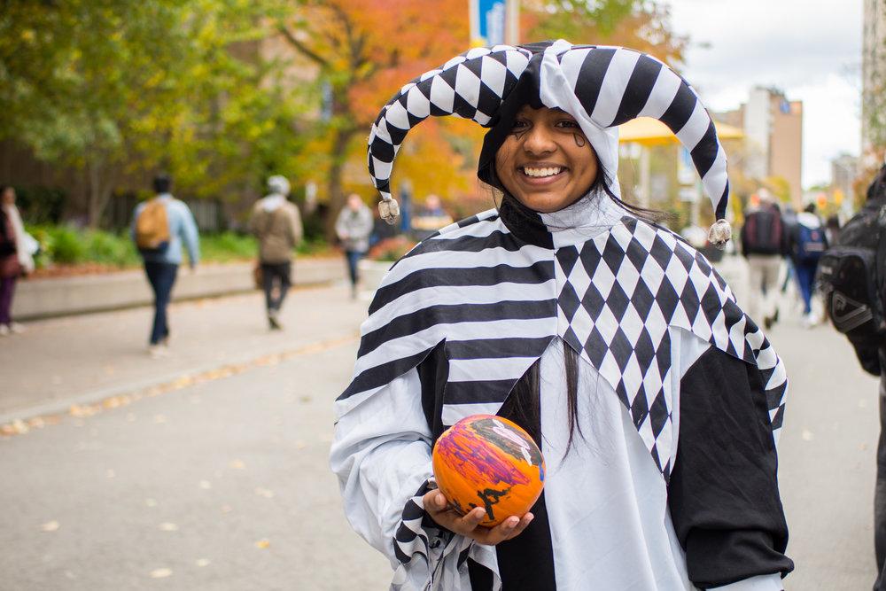 Taniya Peterratnaraj, 19, finishes at the pumpkin drawing station. (J. Cameron/CanCulture)