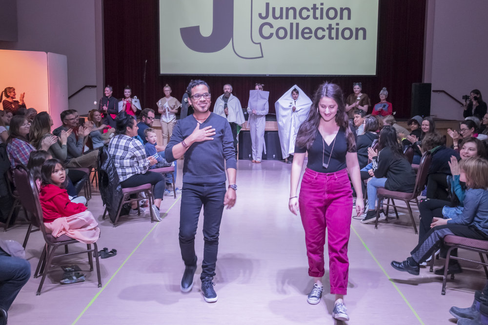 Navarro takes the runway at the end of the show alongside Junction Artist in Residence Program Coordinator Elly Grant. (Courtesy of Bruce Binder Photography)