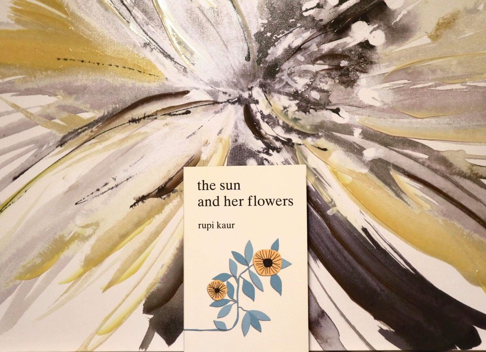 The stark white cover can be seen with illustrations of sunflowers. (CanCulture/Mariah Siddiqui)
