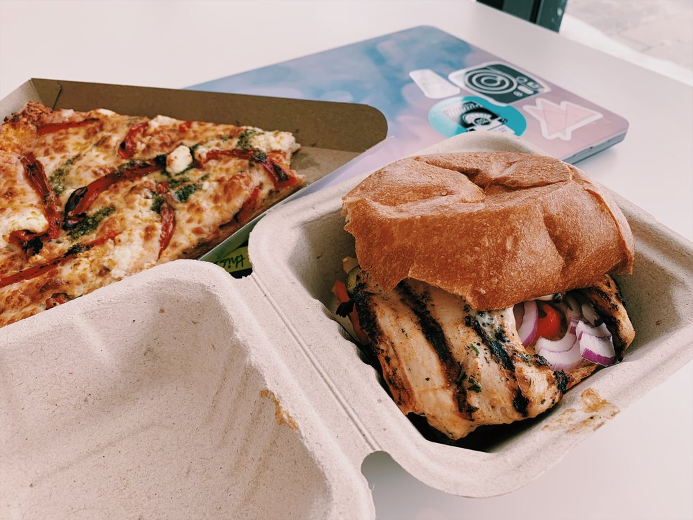 The Flavoursome Grill halal chicken burger and a cheesy pizza slice from the Service Hub Cafe at Ryerson University. (CanCulture/Akanksha Dhingra)