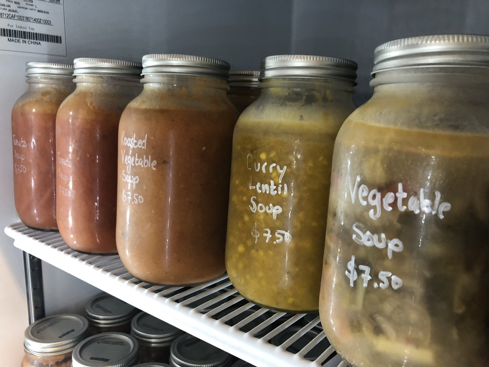 Unboxed Market sells vegetable soups in jars, made in-house from scraps of produce left over from their industrial kitchen underneath the store. (CanCulture/Sophie Chong)