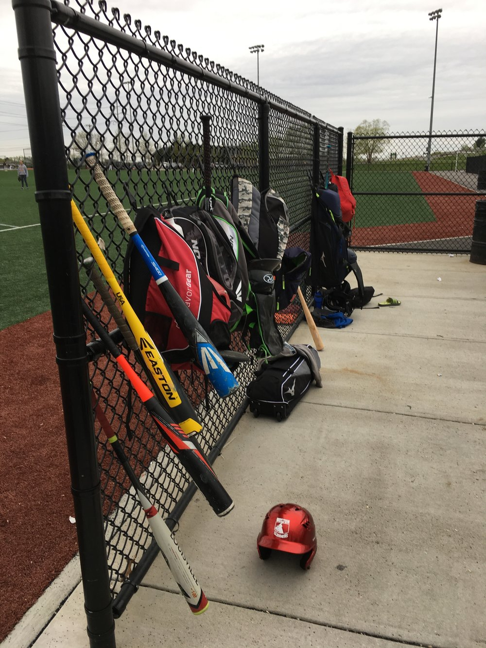 The girls' bats, backpacks and batting helmet.