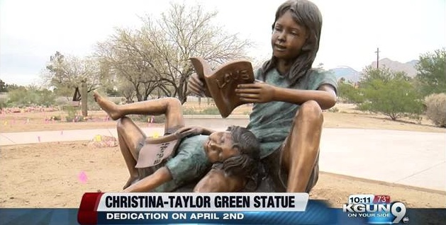 Christina-Taylor Green watched over her younger brother, reading to him as a big sister does. in her memory, this sculpture was dedicated and stands in sad remembrance of this girl who was born on 9/11, who died from when bullets aimed at Representative Gabby Giffords hit her. That was on a morning when Christina, who was nine year old, awakened feeling excited that her neighbor was taking her to meet a woman she admired in politics.