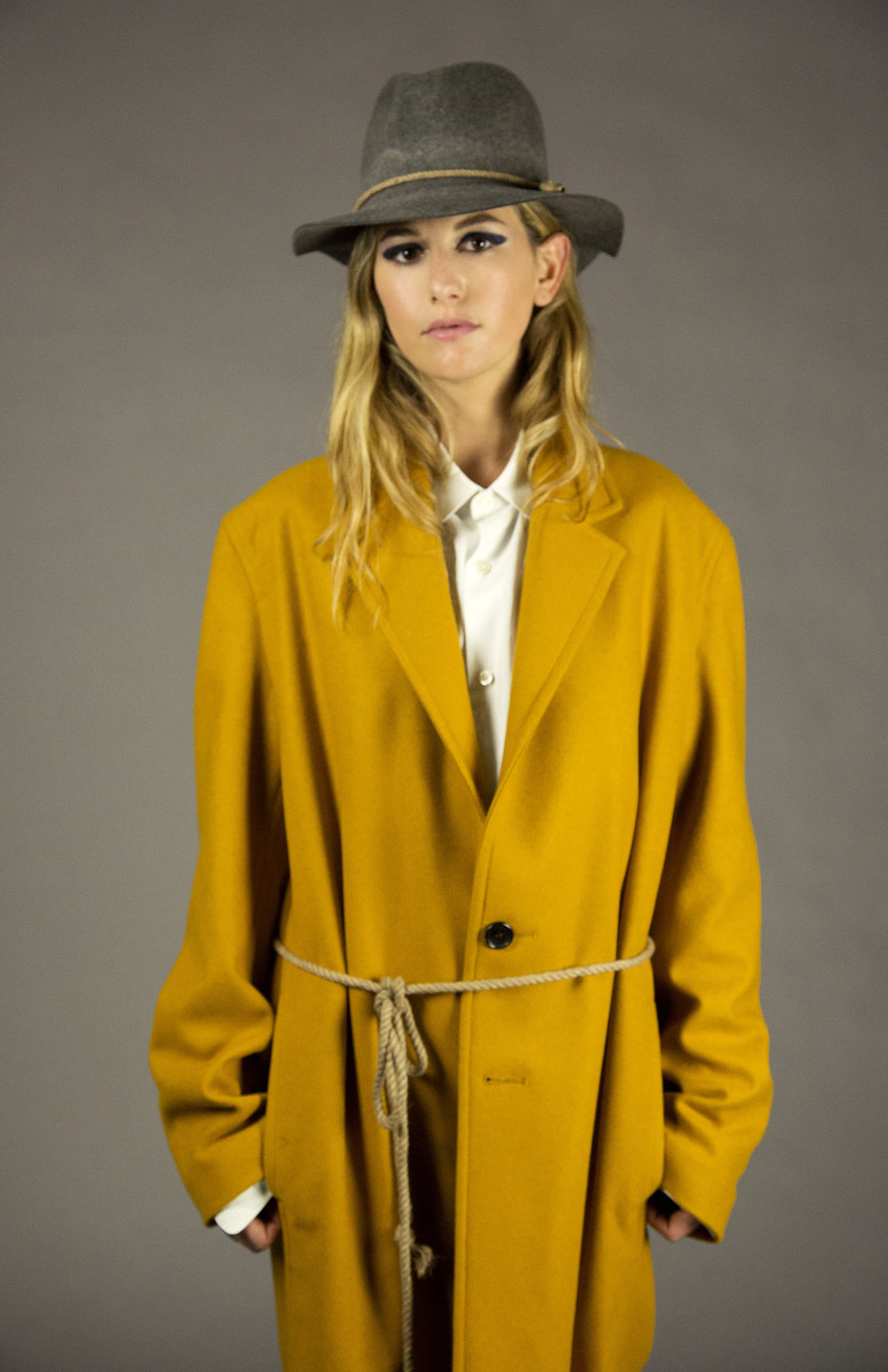 COAT 1 gold  2-button walking coat.oversized fit.drop shoulder. unlined with bias piped seams.natural melange rope detail at neck.natural horn buttons. below knee length.  sizes 0-1-2-3  100% italian felted wool