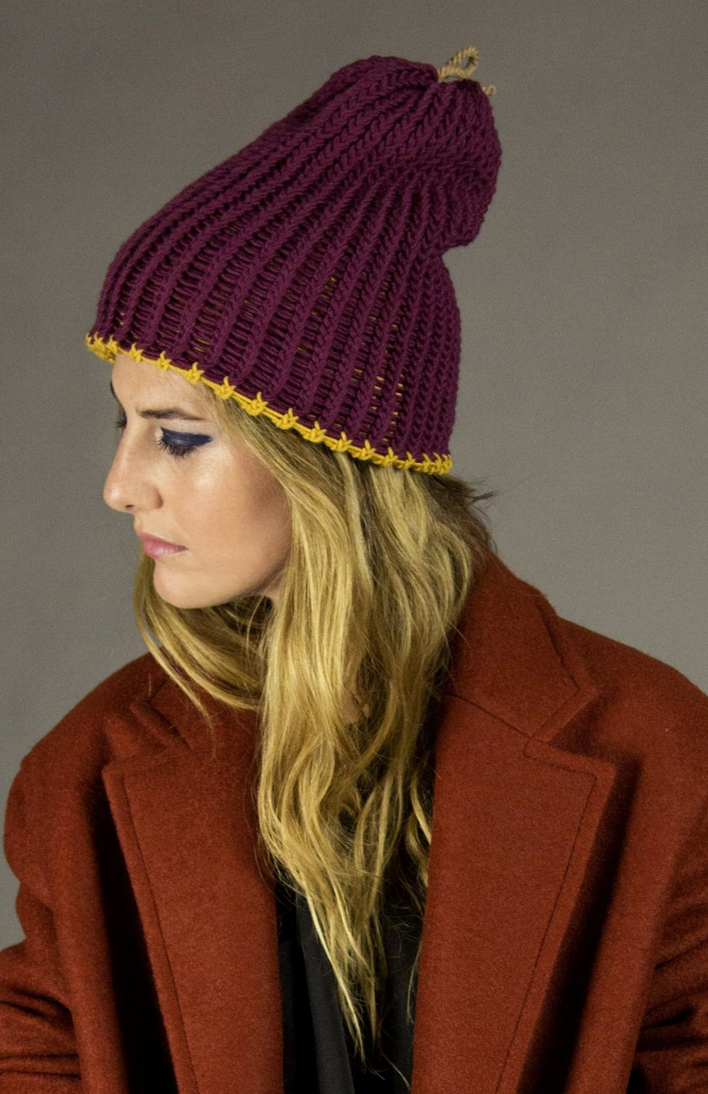 hat 3 deep purple/gold  hand knit long shoreman cap - reversible super washed worsted wool. signature natural melange rope knotted cufflink detail.  one-size  100% super-washed wool