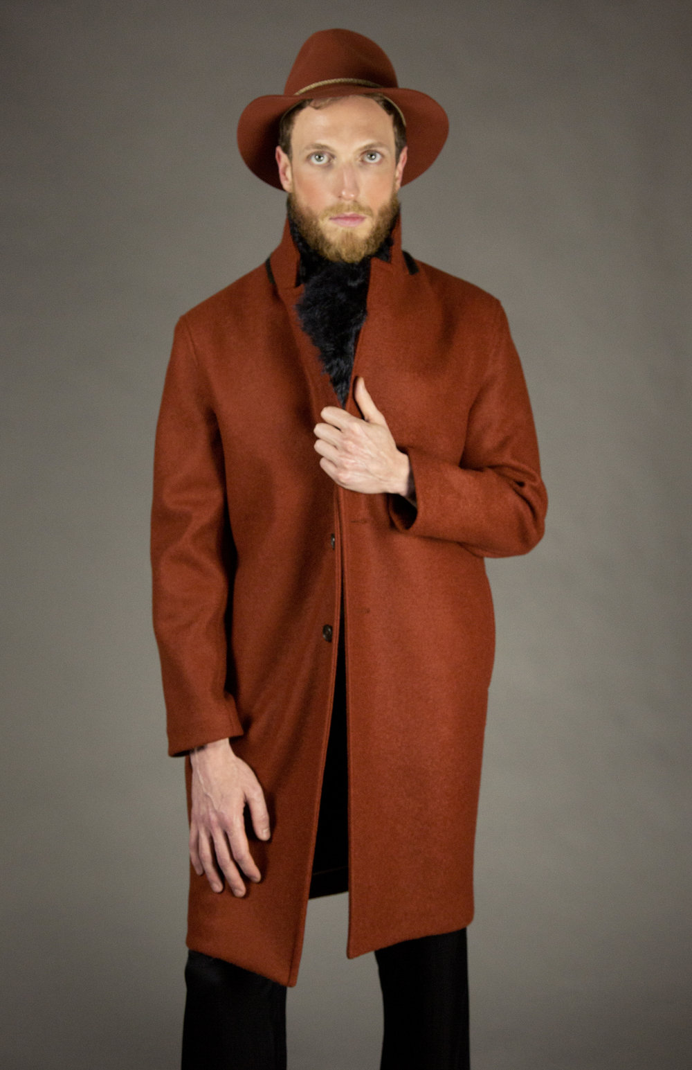 COAT 1 RUST  2-button walking coat.oversized fit. drop shoulder. unlined with bias piped seams.natural melange rope detail at neck.natural horn buttons. below knee length.  sizes 0-1-2-3  100% italian boiled-wool jersey  also available in black