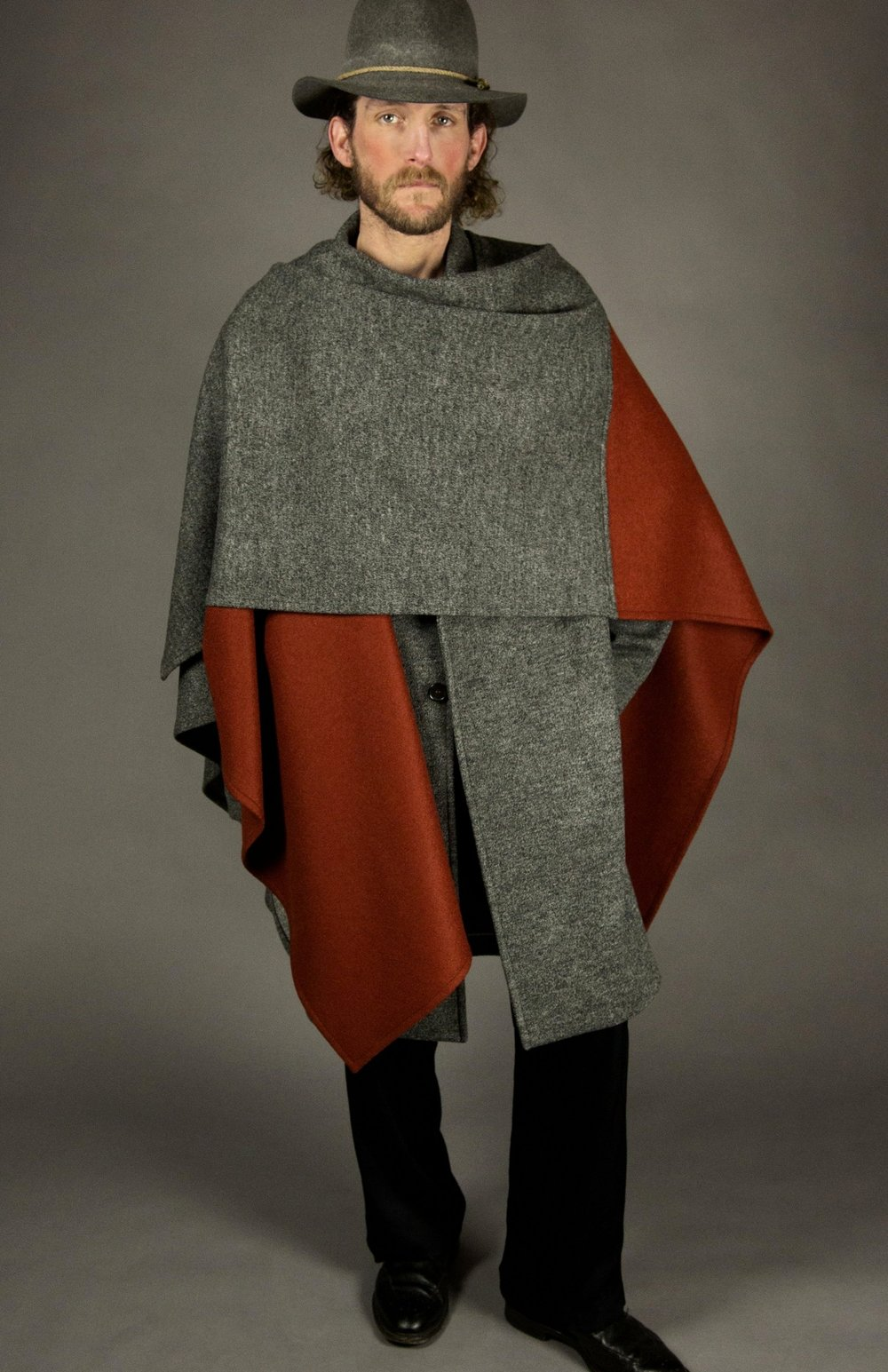 cloak 1 charcoal/rust color block  square-cut blanket wrap with open front.  one size  made in america  100% italian heathered-wool jersey/ 100% italian boiled-wool jersey
