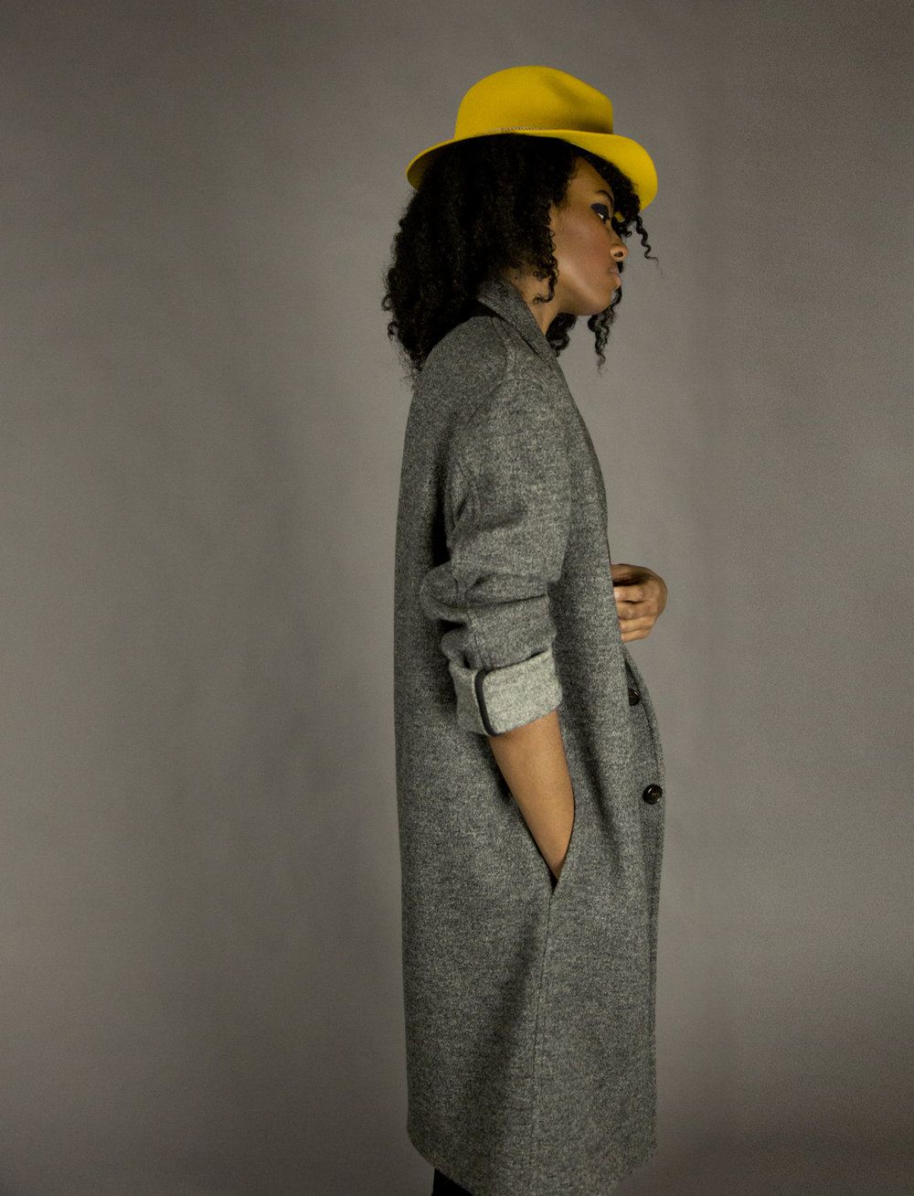 COAT 1 charcoal  2-button walking coat.oversized fit.drop shoulder. unlined with bias piped seams.natural melange rope detail at neck.natural horn buttons. below knee length.  sizes 0-1-2-3  100% italian felted wool