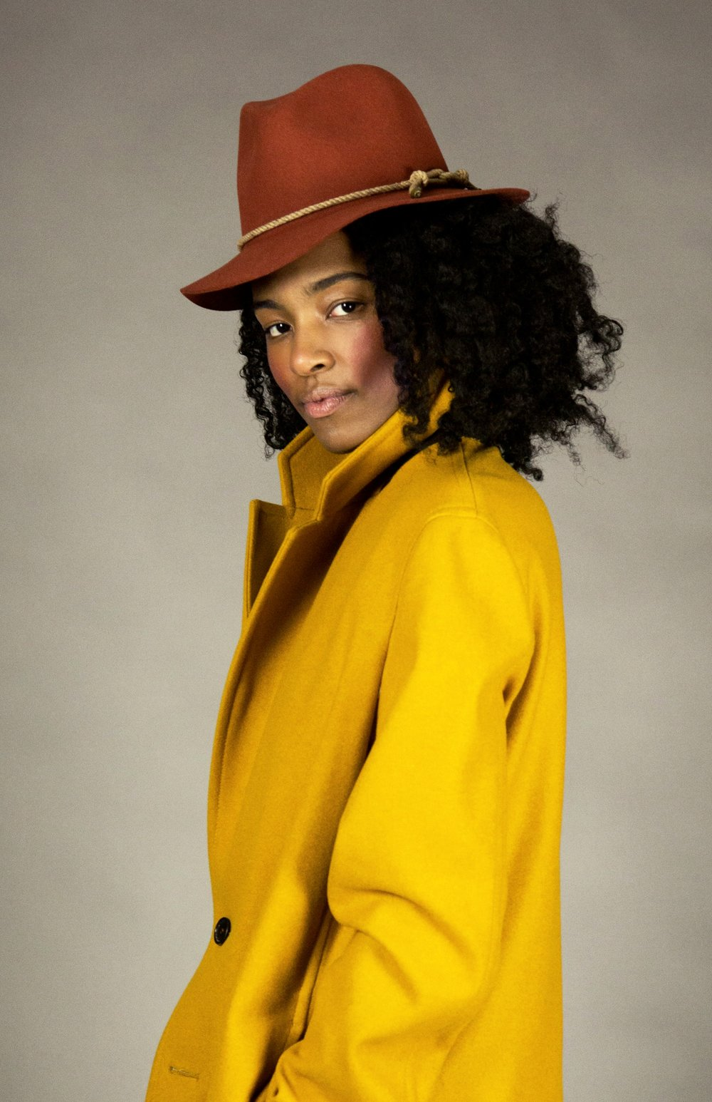 hat 1 rust  felted fedora with signature natural melange rope detail and brass metal tips. made in collaboration with bollman hats, the oldest hat manufacturer in america.  sizes 1-2  100% felted wool  100% cotton interior band in our signature khaki twill