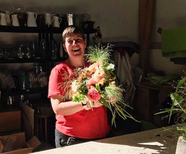 Photo by Leslie of me enjoying bouquet making with lots of lovely customers in my barn at my open day