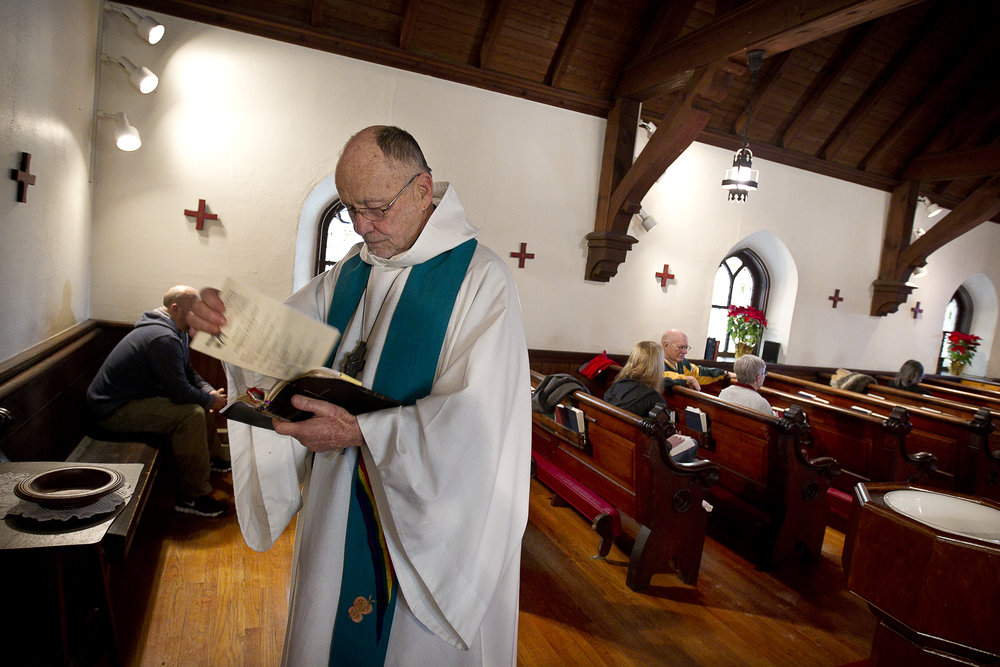 NORTH LAKE, WI — JANUARY 18, 2015: Reverend David Couper prepares his verses before mass at St. Peter's Episcopal Church, Sunday, January 18, 2015.