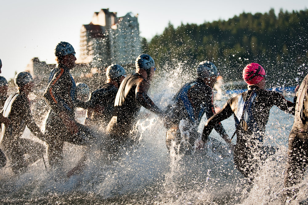 Professional competitors barrel into the beach near Independence Point during the 2010 Ironman Triathlon in Coeur d'Alene, Idaho.