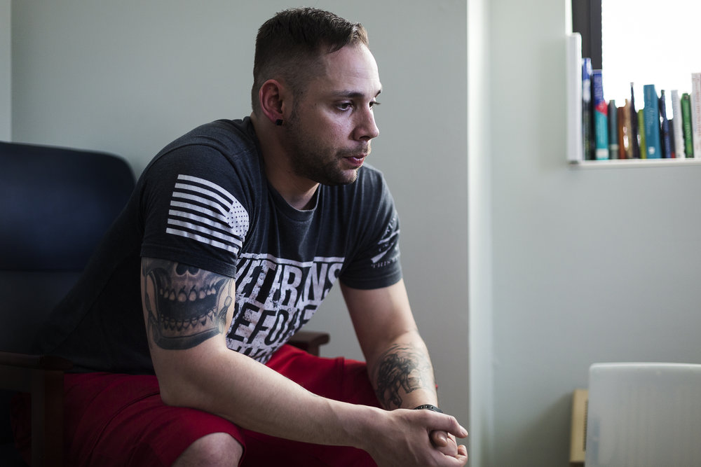 Army veteran Kristopher Heimerl, 30, sits for a portrait at the Tomah VA Facility in Tomah, Wisconsin, Monday, April 23, 2018. Heimerl is currently undergoing treatment for a Traumatic Brain Injury (TBI) as well as combat Post-Traumatic Stress Disorder (PTSD).