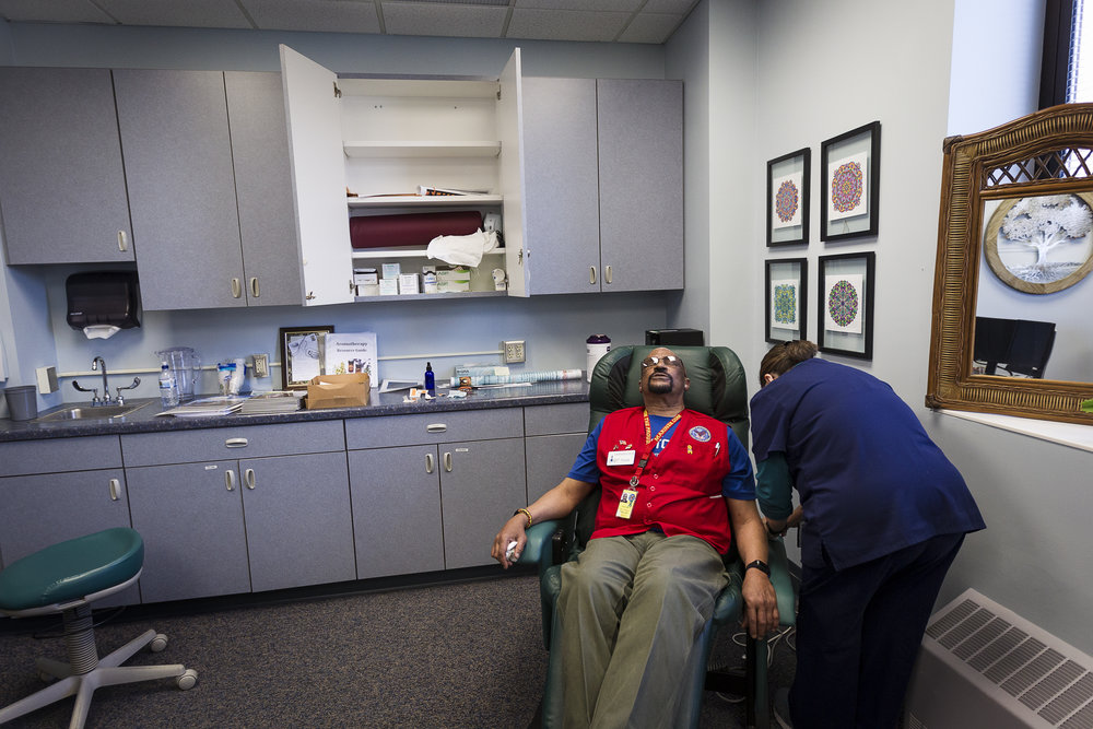 Marine Corps veteran Frank Smith, 62, receives a battlefield acupuncture treatment from Dr. Katherine Pica at the Tomah VA Facility in Tomah, Wisconsin, Monday, April 23, 2018. Smith suffers from chronic lower back pain and says that he feels a great amount of pain relief from the acupuncture treatment, as well as other non-medication therapies at the VA.