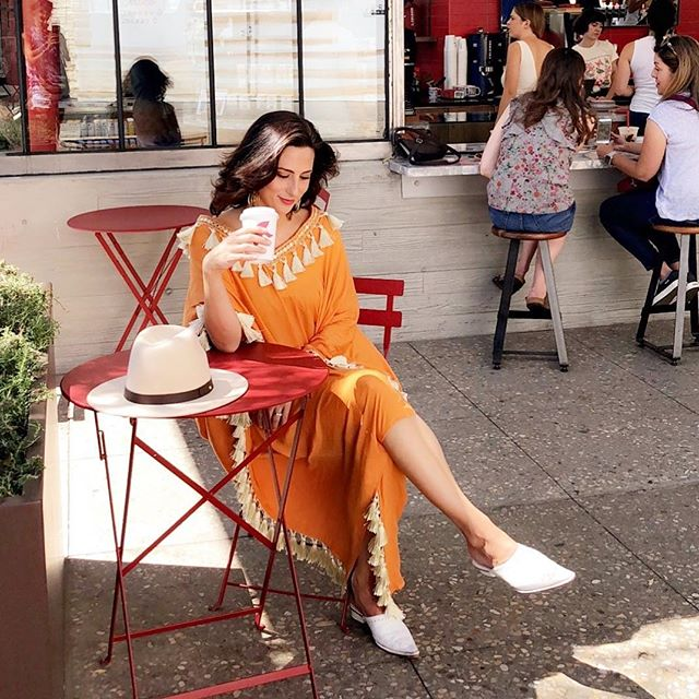 Chasing endless summers and stopping for hot lattes @dollupbydalia in Dahlia Poncho🧡🌟🧡 #poskaresortwear . . . #vacationoutfit ##beachstyle #beachdays #vacationblogger #femmetravel #summerchaser #fashiondaily #breeze #beach #sun #resortwear #poolside #travelessentials #travelwear #getaway #sunnysandiego #california #cali #wearanywhere