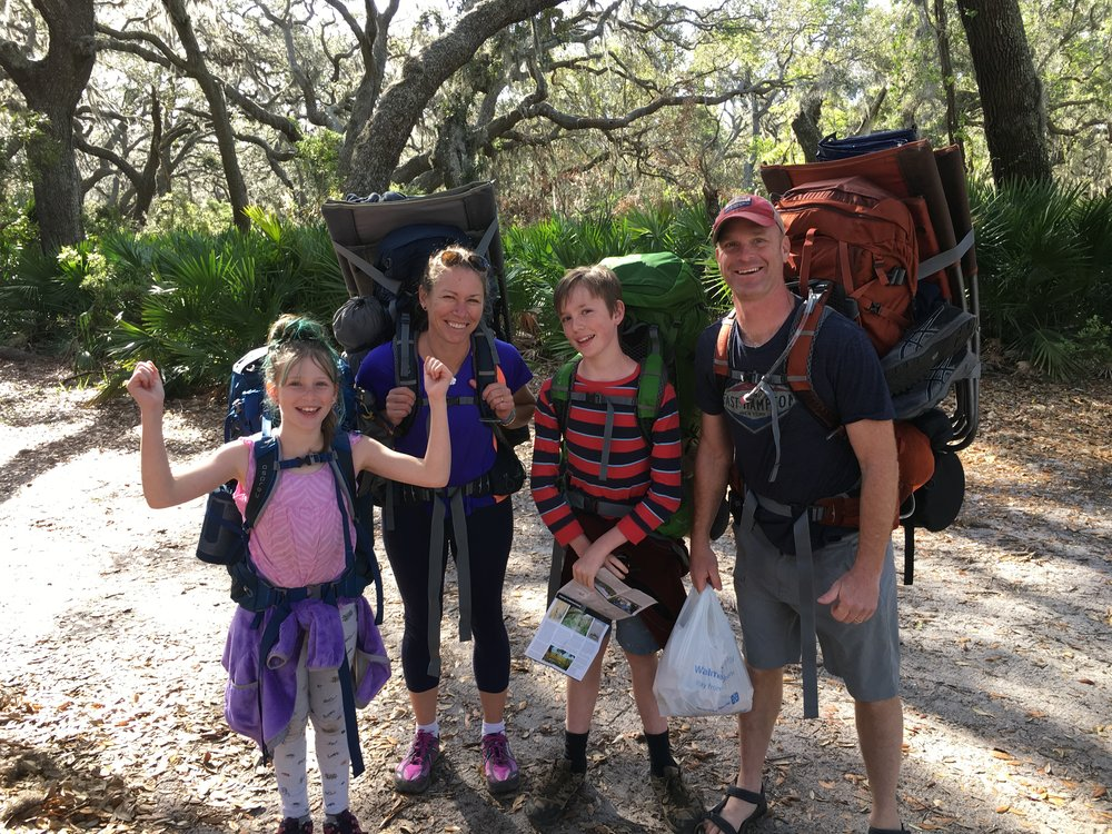 Dr. Carl and his family heading out on a camping trip in Cumberland Island, GA.
