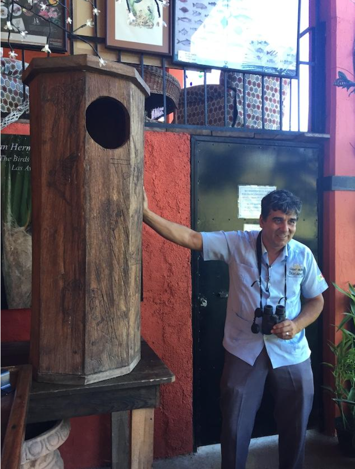 Jorge Novoa    and his wooden Guacamaya nest on display at the Vallarta Botanical Garden